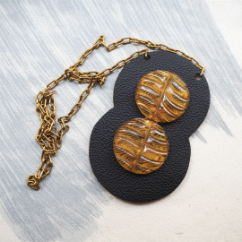 Honey and black leather design necklace